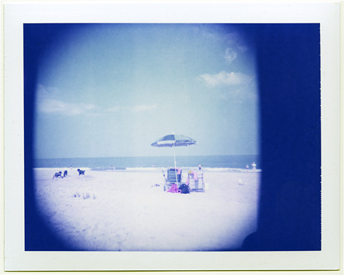 Beach photo taken with Holgaroid on Polaroid's expired 100 blue film