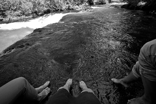 Dipping our feet in the ice cold water by Sahalie Falls, OR