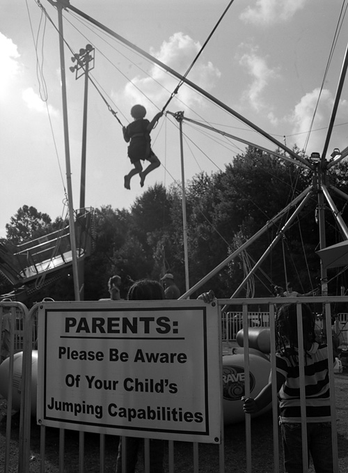 Jumping capabilities at the Arlington County Fair - Shot with the Mamiya m645 on Kodak 100 TMAX film